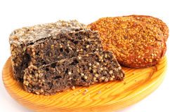 Homemade brown bread and buns with sesame seeds Stock Photos
