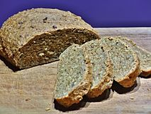 Homemade brown bread. Freshly baked homemade brown bread with four slices royalty free stock image