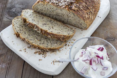 Homemade brown bread. On a rustic wooden table Royalty Free Stock Images