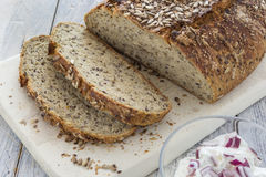 Homemade brown bread. On a rustic wooden table Stock Image
