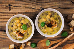 Homemade brown lentil soup with chickpeas Royalty Free Stock Photo