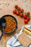 Homemade Brown Lentil soup. With Carrots Onions and Tomatos and cheese soldiers and bread on wooden rustic backgrouns stock photos