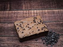 Homemade Brownie with chocolate chip on wood background stock image