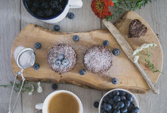 Homemade brownies with blueberries, coffee, flower, sugar decor royalty free stock image
