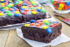 Homemade brownies with chocolate ganache and candies Royalty Free Stock Image
