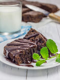 Homemade brownies with chocolate sauce. And glass of milk Royalty Free Stock Photos