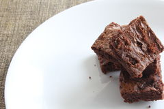 Homemade brownies. Gourmet brownies on white plate Royalty Free Stock Images