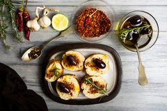 Homemade bruschetta with ingredients on a table stock image