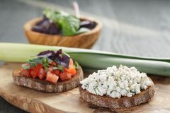 Homemade bruschetta with tomatoes, basil and leek. On olive board royalty free stock images