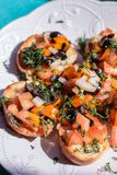 Homemade bruschetta with tomatoes and olives stock images