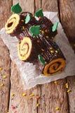 Homemade buche de noel, chocolate yule log christmas cake.  Royalty Free Stock Photo