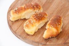 Homemade bun rolls on wooden board Royalty Free Stock Photos