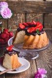 Bundt cake with chocolate ganache glaze and fresh strawberries royalty free stock photos