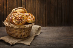 Homemade buns in a basket Stock Images