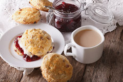 Homemade buns with jam and tea with milk close-up. horizontal Stock Images