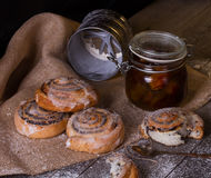 Homemade buns with poppy seeds, jam Royalty Free Stock Photo