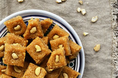 Homemade burfi - indian sweets with chickpea flour and cashew nut Royalty Free Stock Images