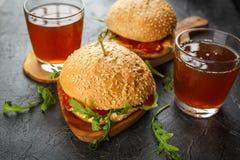 Homemade burger with arugula, tomato and cheese Royalty Free Stock Photos