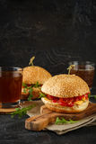 Homemade burger with arugula, tomato and cheese Stock Images