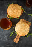 Homemade burger with arugula, tomato and cheese Royalty Free Stock Images