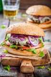 Homemade burger with beef cutlet, apple, lettuce, onion and blue cheese Stock Photography