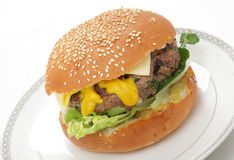 Homemade burger in bun Royalty Free Stock Photos