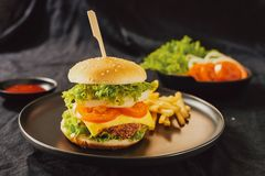 Homemade burger and cheese with fries and icy soft drink.  stock photo