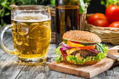 Homemade burger and a cold beer Royalty Free Stock Image