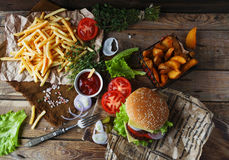 Homemade burger, fried potatoes, french fries, fast food set stock image
