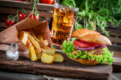 Homemade burger made with chicken, fries and cold drink Stock Images