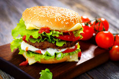 Burger. Homemade burger on  wooden background Stock Photo