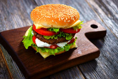 Burger. Homemade burger on  wooden background Stock Image