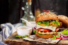 Homemade burger on the wooden table Royalty Free Stock Photography