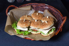 Homemade burgers in a basket Royalty Free Stock Photography