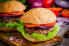 Homemade burgers with fresh organic vegetables Stock Photos