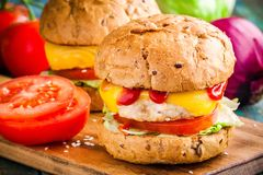 Homemade burgers with fresh vegetables and chicken cutlet closeup Royalty Free Stock Image