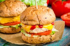 Homemade burgers with fresh vegetables and chicken cutlet closeup Stock Photos