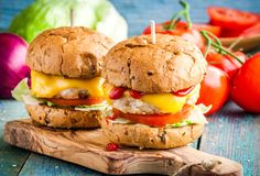 Homemade burgers with fresh vegetables and chicken cutlets Royalty Free Stock Photo