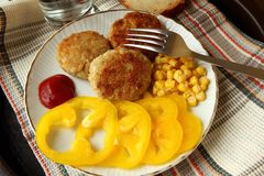 Homemade burgers with sweet peppers and corn Stock Photos