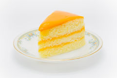Homemade butter cake with orange source on top Royalty Free Stock Images