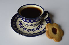 Homemade butter cookies. Homemade cookie, flower cake, daisy cookie, shortbread butter cookie with marmalade / jam, cookies with cup of coffee stock photo