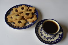 Homemade butter cookies. Homemade cookie, flower cake, daisy cookie, shortbread butter cookie with marmalade / jam, cookies on plate, cookies on decorative stock photo