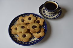 Homemade butter cookies. Homemade cookie, flower cake, daisy cookie, shortbread butter cookie with marmalade / jam, cookies on plate, cookies on decorative stock photos