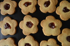 Homemade butter cookies. Homemade cookies, flower cakes, daisy cookies, shortbread butter cookies with marmalade / jam Stock Image