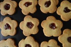 Homemade butter cookies. Homemade cookies, flower cakes, daisy cookies, shortbread butter cookies with marmalade / jam stock image