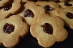 Homemade butter cookies. Homemade cookies, flower cakes, daisy cookies, shortbread butter cookies with marmalade / jam royalty free stock photos