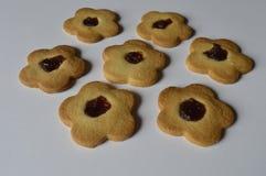 Homemade butter cookies. Homemade cookies, flower cakes, daisy cookies, shortbread butter cookies with marmalade / jam stock photo