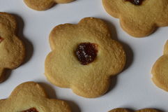 Homemade butter cookies. Homemade cookies, flower cakes, daisy cookies, shortbread butter cookies with marmalade / jam royalty free stock images