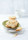 Butter cookies with pistachios on a plate Stock Image