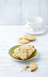 Butter cookies with pistachios on a plate Royalty Free Stock Photos